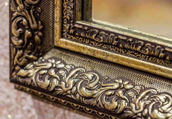 Mirror detail with ornate gold frame