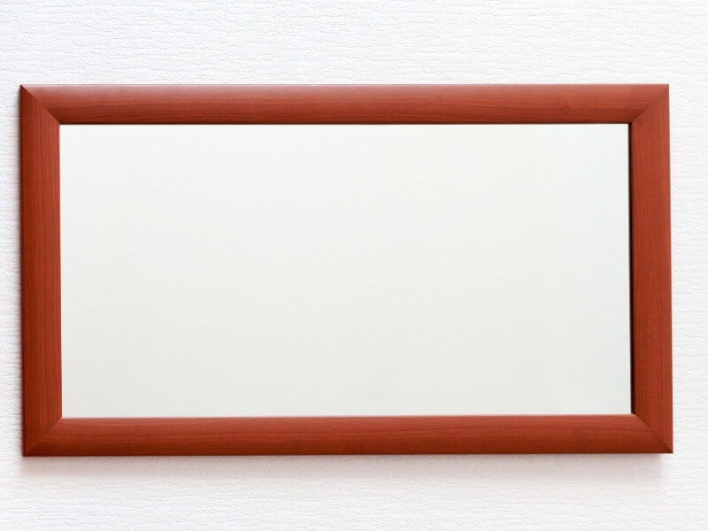 Mirror framed in contemporary red frame